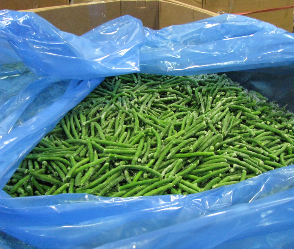 Frozen green beans ready for processing.