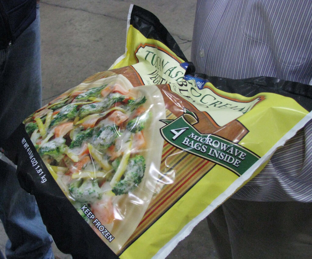After being weighed and sorted, broccoli, orange carrots and yellow carrots are packaged into Tuscan Asiago Cream Vegetable packages.